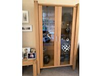 Solid oak display cabinet with glass shelves