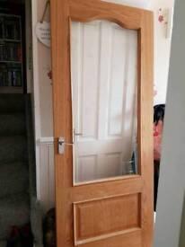 Solid oak door with glass panel