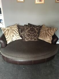 Large brown leather and fabric sofa and cuddle chair