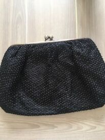 Black jigsaw clutch bag with gold beads