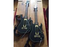 Pair of guitar hero guitars