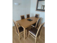 As new oak and brown leather effect six seater set