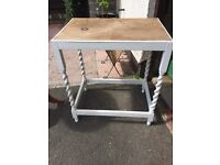 Feature wooden table with twisted legs