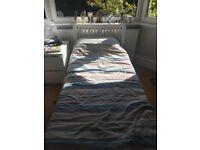 White wooden single bed frame
