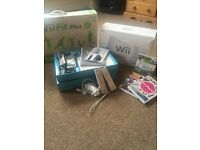 White Nintendo Wii Console, boxed Wii Fit Plus, 2 controllers, 1 nunchuck and three games