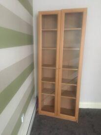 Ikea bookshelf with glass doors