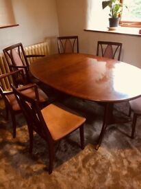 Beautiful teak and rosewood extending oval dining table and matching chairs by G Plan