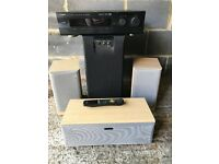 Yamaha surround sound processor + active sub, centre and 2 rear speakers.