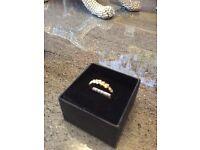 2 ladies 9 carat eternity rings