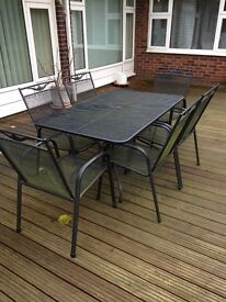 High grade patio table and six chairs with attachable padded seating