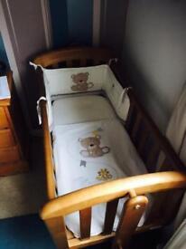 Swinging pine crib, mattress and bedding