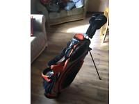 Golf bag and 2 clubs