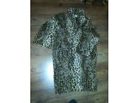 Ninivah khomo lady leopard print coat in excellent condition.