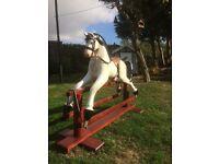 Rocking Horse - Fibreglass body on wooden swing frame