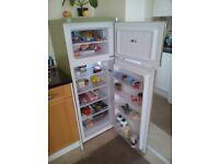 Fridge Freezer almost new: good condition. 145 x 55 x 55 cm.