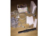 Nintendo Wii in working order and 4 controllers