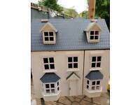 Large wooden dolls house complete with loads of furniture