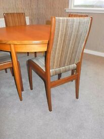 GPlan Extending Teak Dining Table and four chairs. Round table extending to oval