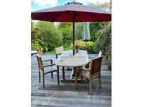 Teak garden table with parasol