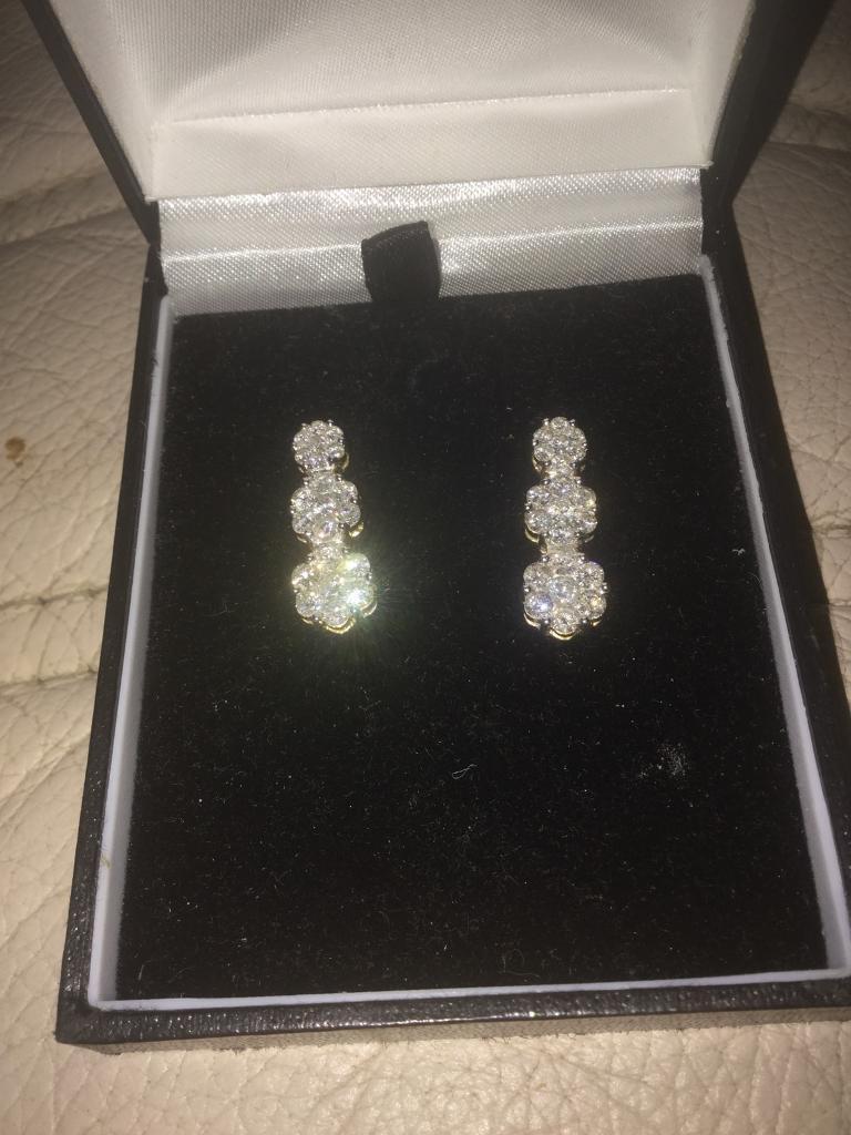Ladies white gold design earrings