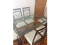 Glass dining table and 6 chairs hardly used.