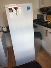 Below tall larder fridge. Only bought in August but too big for new house.