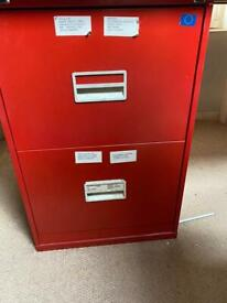 2 red filing cabinets