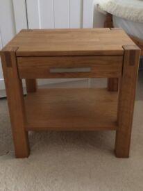 Smart, hardwood bedside table with slim metal handle