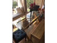 Glass dining table and benches. Very good quality.