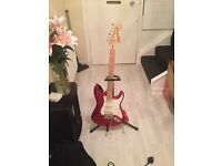 Never used electric guitar, stand and amp like new