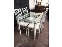 Glass and metal 4 seater dining suite.