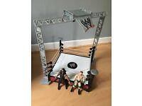 WWE wrestling ring with figures and belt