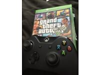 X box one with 2 pads grand theft v five and ufc 2
