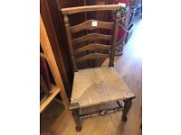 Wooden ladder back chair , with woven seat Good condition . Older type of chair
