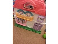 Toy dolls house with accessories