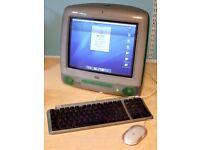 Original Apple iMac G3 running 10.4 Tiger with matching keyboard.