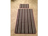 Brand new plum colour stripe rug and smaller mat