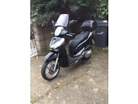 HONDA SH 300 2011 BLACK. SERVICED WITH NEW MOT