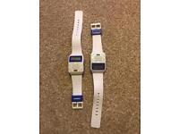 2x white cheapo electronic watches