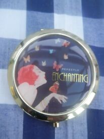 "Jitterbug ""Perfectly enchanting"" compact"