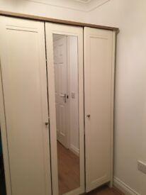 Wardrobe- Cream & light wood trim with mirror.