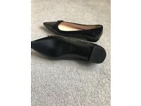 Prada black patent flat shoes