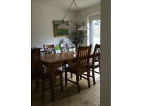 Set of dinning room in very good condition: table, 6 chairs, 2 cupboards and coffee table
