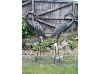 Two metal herons