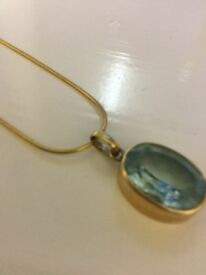 9 ct gold blue topaz pendant and chain