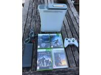 Xbox 360 console with halo games.