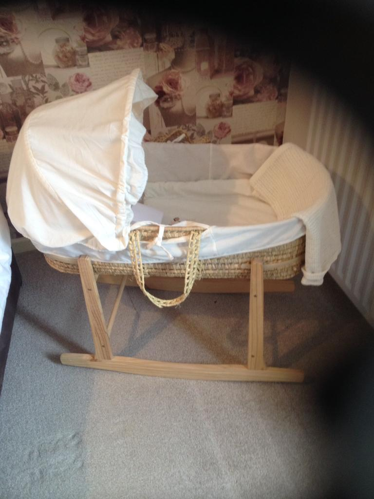 Cute as a button Moses basket with rocking stand