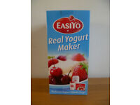 EasiYo yogurt maker, container and instruction book with about 15 recipes.