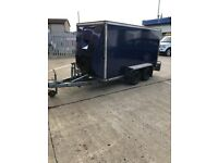 Bateston Box trailer with tilt action and ramp tailgate.