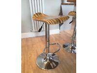 4 unusual tiger striped adjustable height bar stools .